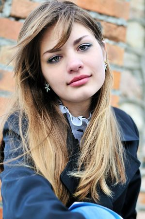 14 15 years: prtrait of teen girl near the brick wall Stock Photo