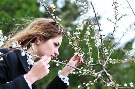 longhaired teen girl near the first spring blossom Stock Photo - 6711066