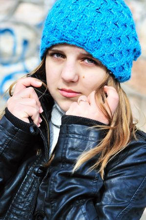 teen girl wearing blue hat and leather jacket Stock Photo - 6807916