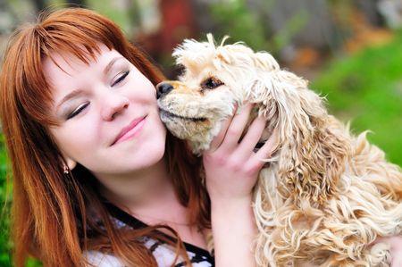 american cocker spaniel kissing redheaded dirl photo
