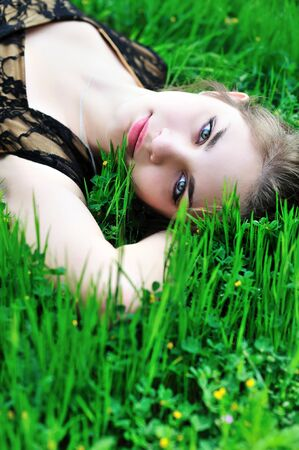 beautiful young teen girl laying on the spring meadow Stock Photo