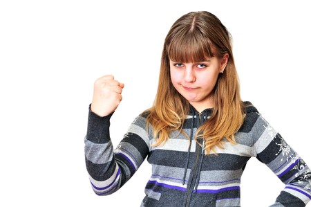 angry funny teen girl shaking  her fist  photo