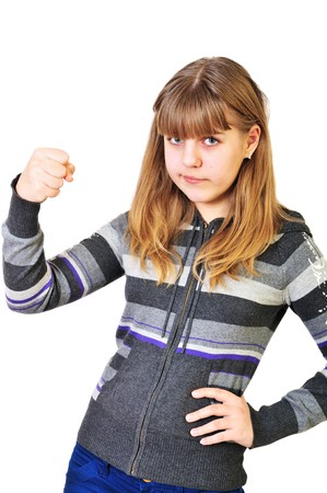 annoyed girl:  angry funny teen girl shaking her fist  Stock Photo