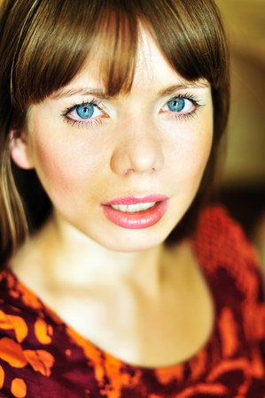 bright portrait of young woman in soft selective focus photo