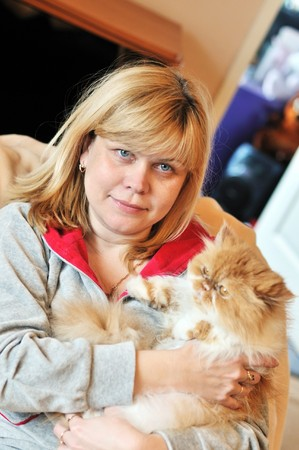 woman with her persian  cat relaxing at home Stock Photo - 7138402