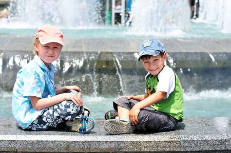 waterworks: two little boys playing near waterworks;