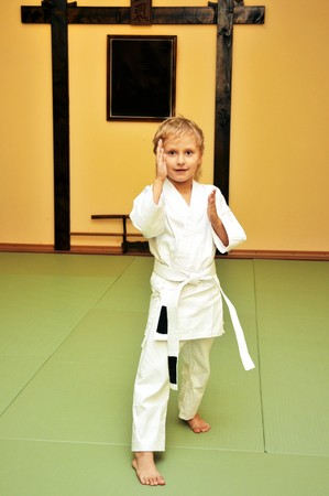 little boy has just got his first white belt in aikido photo