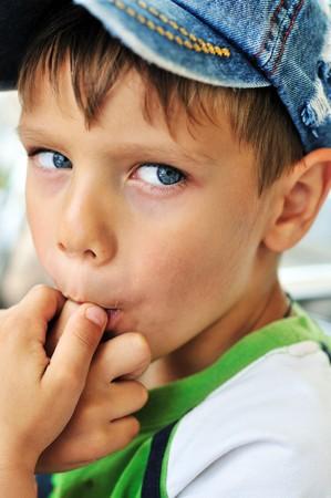 licking finger: little boy licking his finger