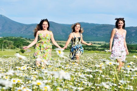 teen pretty girls running in daisy field Stock Photo - 7216561