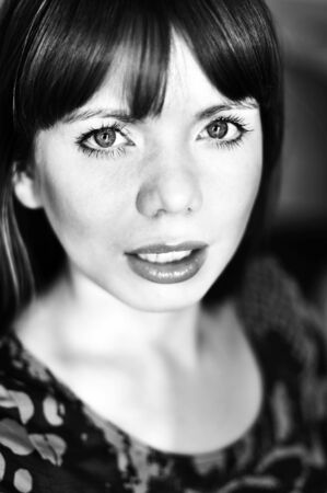 bright portrait of young woman in soft selective focus and  in black and white  photo