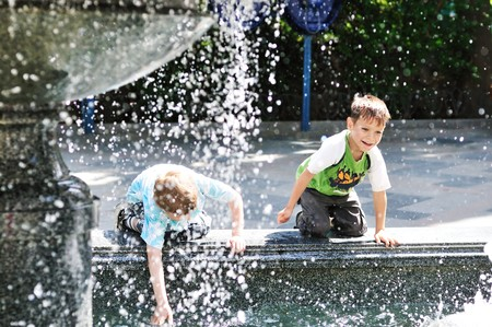 waterworks: two little boys playing near the waterworks Stock Photo