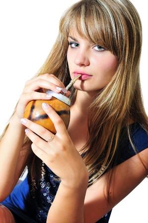 girl drinking mate she using calabash and  bombilla photo