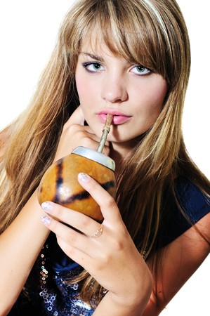 girl drinking mate she using calabash and bombilla photo