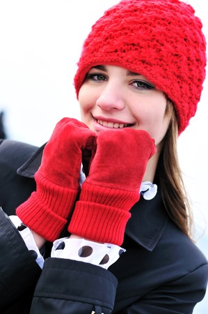 reg: girl wearing reg hat and red gloves outdoors