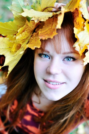 gril: autumn redheaded gril with crown from leaves Stock Photo
