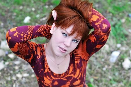 angle shoot of redheaded girl outdoors  photo