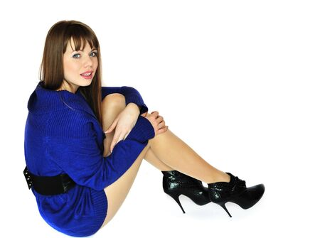 fashion sitting girl wearing blue dress and high heel shoes  photo