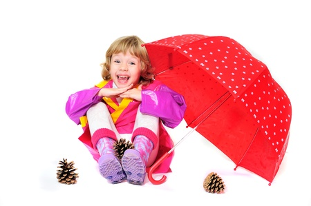 happy girl wearing raincoat and boots with umbrella photo