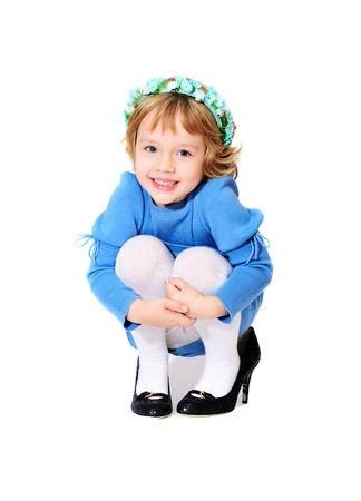 happy little girl wearing mothers shoes Фото со стока