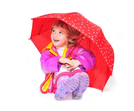 happy girl wearing raincoat and boots with umbrella  Stock Photo