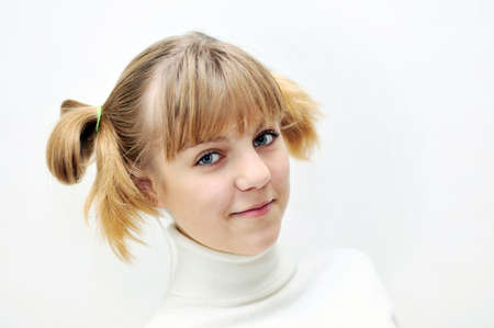 portrait of teen blonde girl with funny hairstyle photo