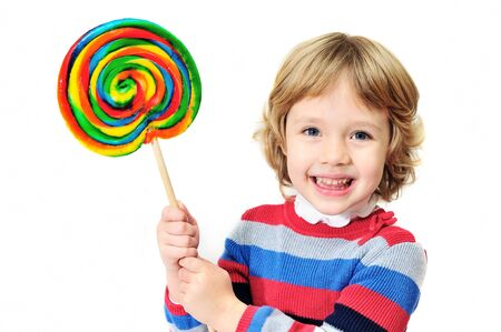 little laughing  girl holding big colorful lollipop photo