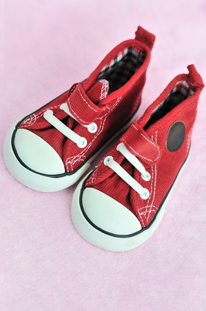 shoes for little baby girl on pink background in soft focus photo