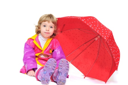 little girl with umbrella making face over the white photo