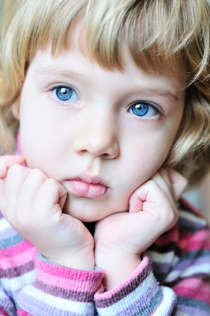 Portrait of a beautiful thoughtful blonde young girl  photo
