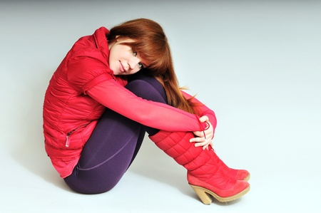 redheaded girl wearing  red clothes photo