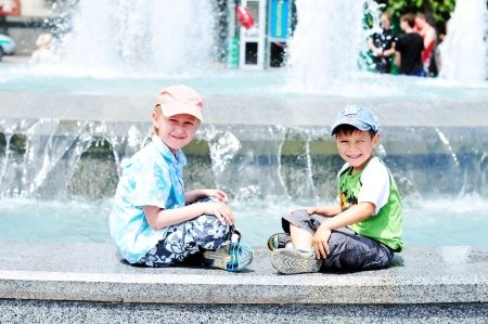 waterworks: two little boys having fun  near waterworks