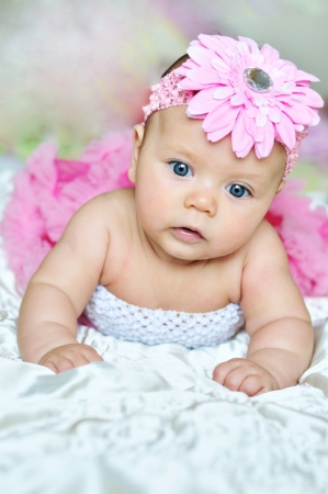 3 monthes old baby wearing pink beautiful clothes Stock Photo - 14089882