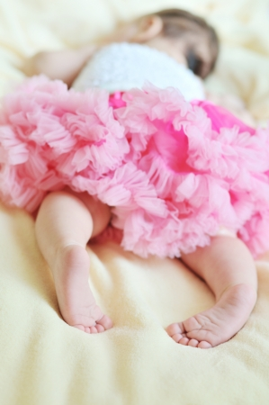 dreams of baby princess (2 monthes girl sleeping wearing pink skirt) Stock Photo - 14089623