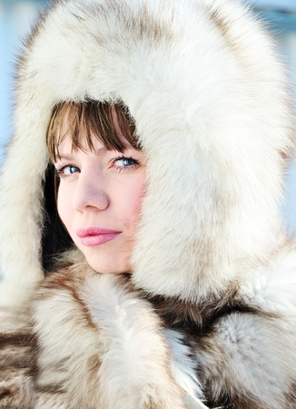 Young woman wearing fur and big hat photo