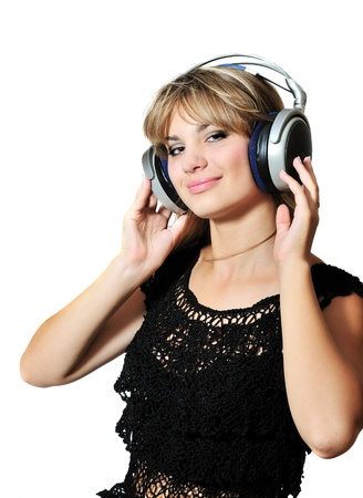 happy lovely teen girl dancing with headphones photo