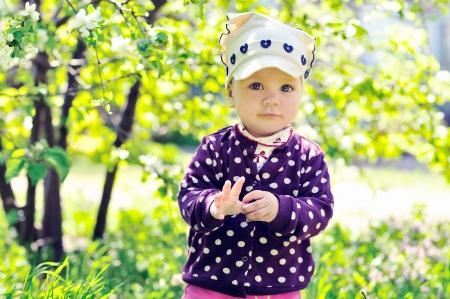 sweet baby girl  in the blossom  garden