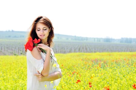 young beautiful girl  in blossom field photo