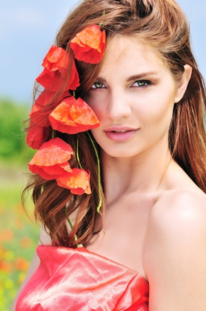 portrait of awesome beautiful girl with poppies photo