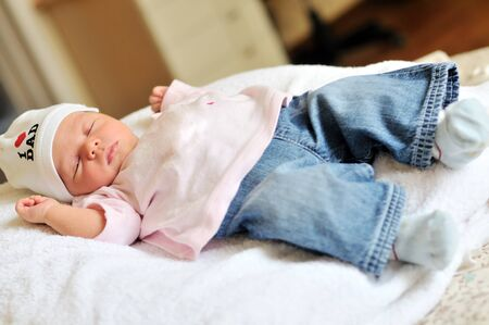cute newborn girl wearing jeans Stock Photo - 14090989