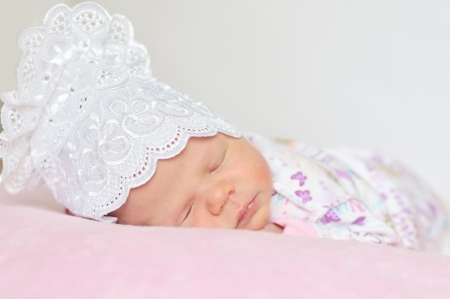 sweet newborn girl dreaming at home  Stock Photo - 14090863