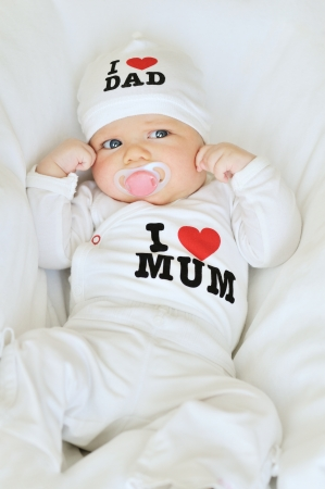 newborn girl wearing clothing with love to mum and dad  not trademark  Stock Photo - 14090876