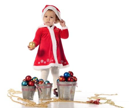 Santa helper little girl standing with ball Stock Photo - 18149380