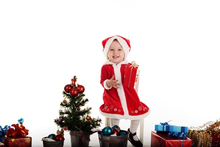 santa baby girl sitting on the chair Stock Photo - 18150067