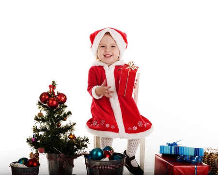santa baby girl sitting on the chair Stock Photo - 18149809