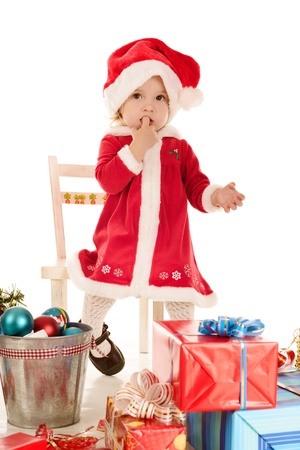 surprised santa girl sitting on the chair Stock Photo - 18149939