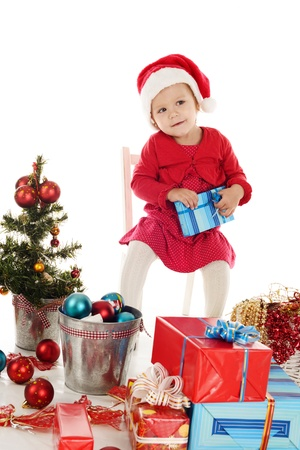 Santa helper with gift sitting on the chair Stock Photo - 18150307
