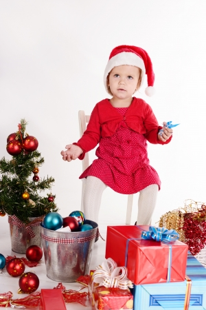 little santa helper sitting on the chair photo