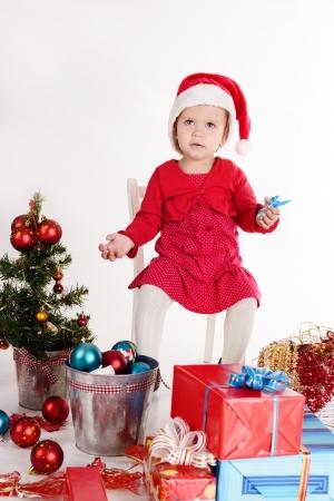 little santa helper sitting on the chair Stock Photo - 18150318