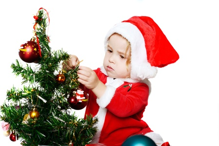 baby Santa girl decorating a new year tree Stock Photo - 18149299