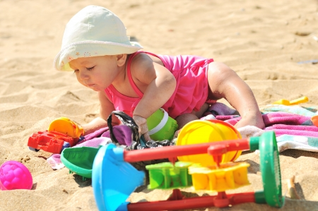 baby girl playing on the beach Stock Photo